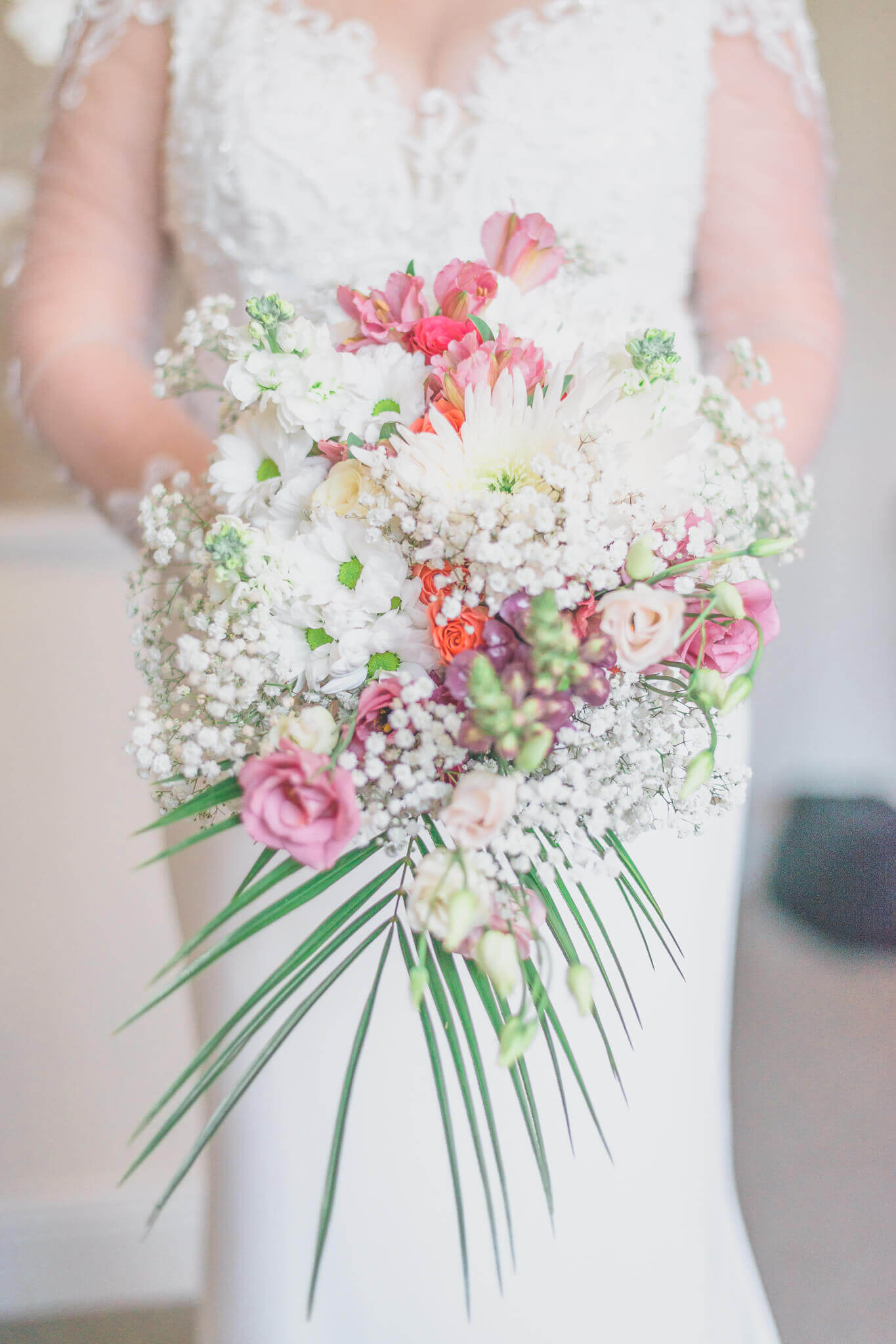 Bride with flowers photo by Ryan Hewett Photography
