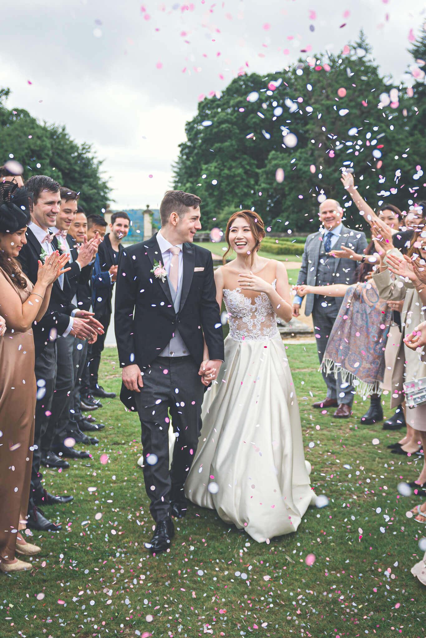 Bride & Groom confetti ©Ryan Hewett photography
